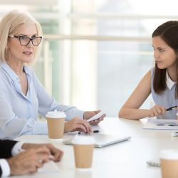 Female leader with employees