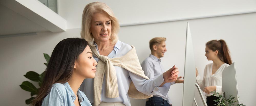 Female mentor helping employee