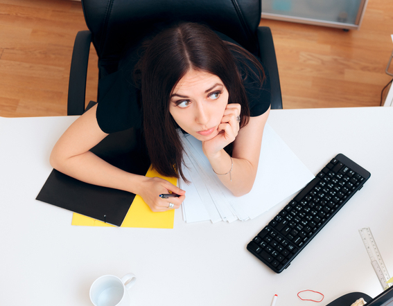 woman at desk spacing out